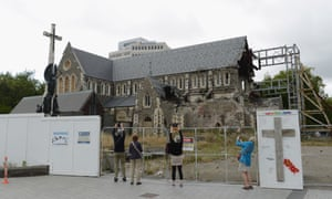 Tourists take photos of the Christchurch Cathedral.