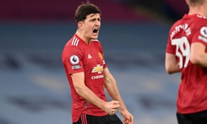 Harry Maguire celebrates on the final whistle as United end Manchester City's winning run.