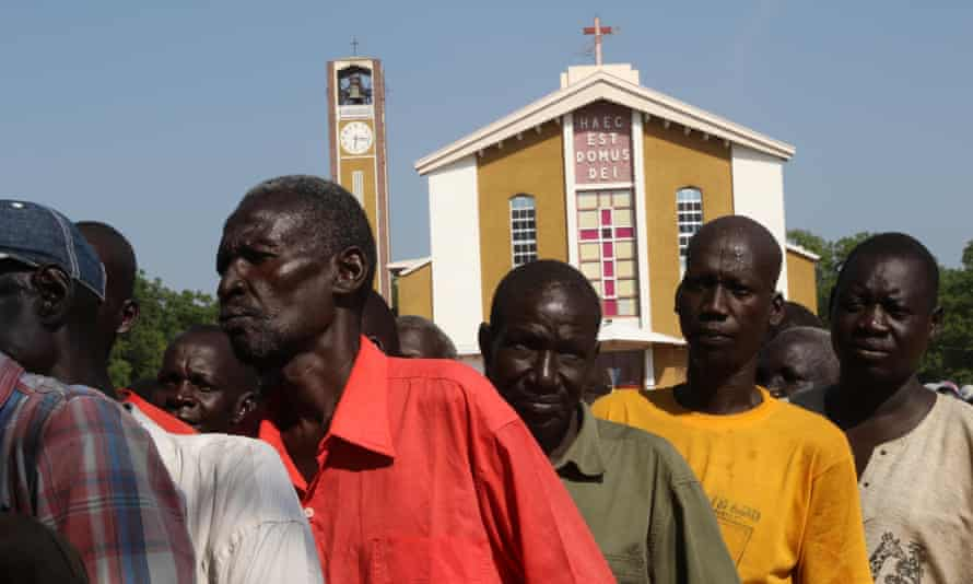Displaced people line up to receive aid at St Theresa cathedral in Juba, where more than 2,000 people are seeking shelter.