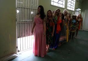 Women beside bars