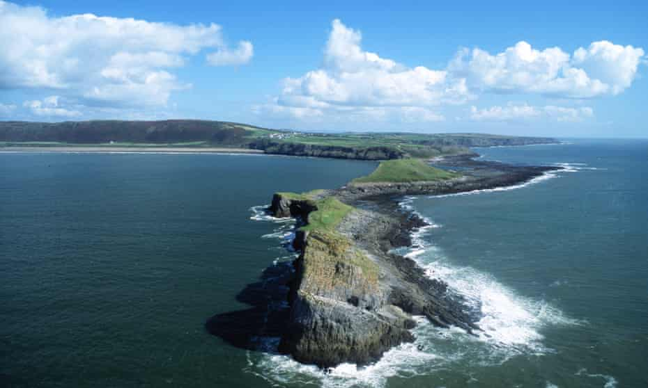 Worm's Head and Rhossili Bay beach aerial view Gower Peninsula Swansea County South Wales UK.