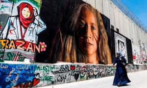 A mural on Israel's 'separation barrier' in the West Bank city of Bethlehem, depicting Palestinian teenager Ahed Tamimi, imprisoned by Israel, and Palestinian paramedic Razan al-Najjar, who was shot dead by Israeli soldiers in Khan Yunis in the Gaza Strip