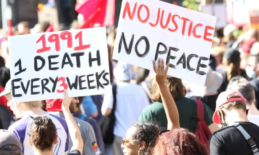 protesters at an Australian Black Lives Matter march with placards
