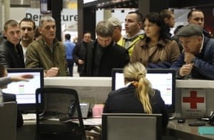 People gather at the airline information desk at of Russian airline Kogalymavia's desk at Pulkovo airport in St Petersburg