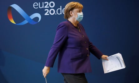 Angela Merkel leaving a news conference in Berlin