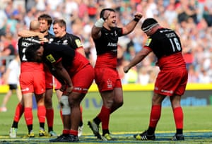 Saracens players celebrate at the final whistle.