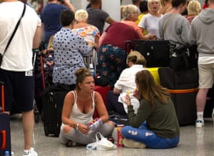 Passengers of British travel group Thomas Cook wait at Son Sant Joan airport in Palma de Mallorca