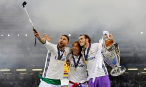 And a selfie stick. Sergio Ramos, Luka Modric and Gareth Bale smile for the camera.