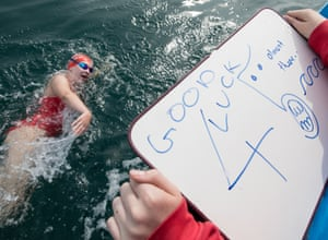 Ruby writes an encouraging message to Grace during her first swim