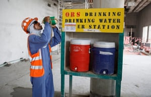 A migrant worker drinks water at the al-Rayyan stadium site.
