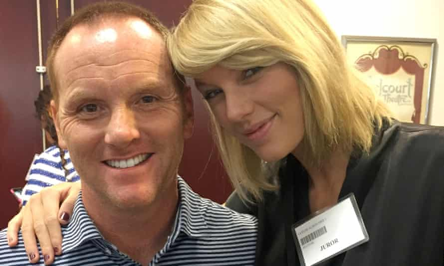 Taylor Swift poses for a photo with Bryan Merville, another potential juror, in a courthouse waiting area in Nashville.