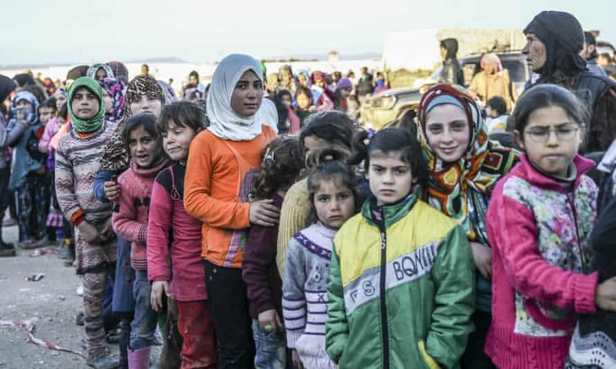 Syrians at the Turkey-Syria border near Aleppo in February.