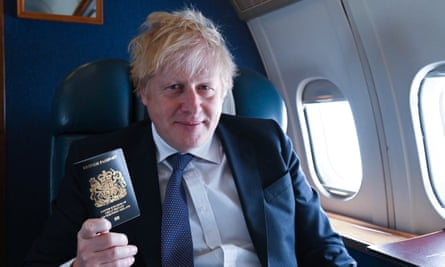 Boris Johnson with the new blue British passport. The prime minister will unveil the UK's negotiating mandate this week.