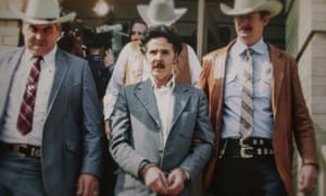 Henry Lee Lucas (center) being escorted by Ranger Bob Prince (left) and task force