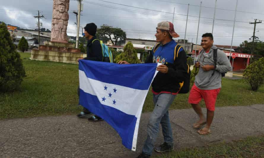 Honduran migrants taking part in the second caravan towards the US, on their way to the border with El Salvador, on Tuesday.