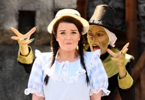 Cast members from The Wonderful Wizard of Oz perform during a photocall at the Scoop in London
