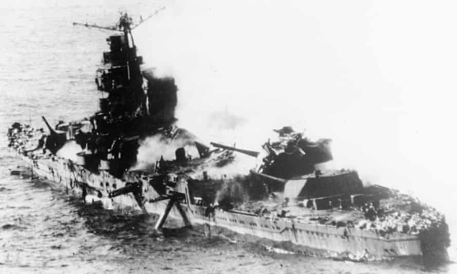 Japanese heavy cruiser of the Mogami class lies low in the water after being bombed by US naval aircraft during the Battle of Midway.