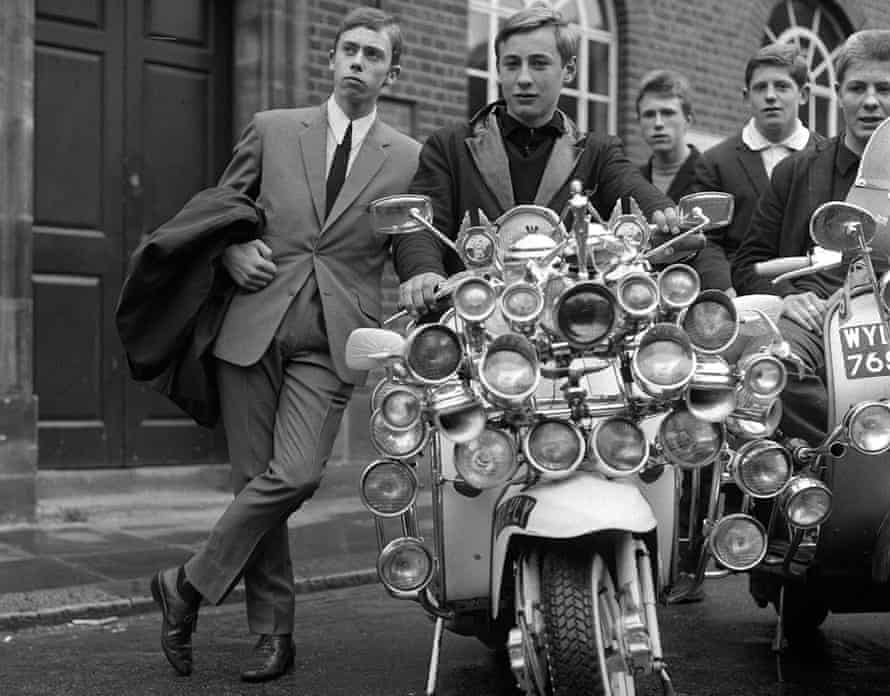 The look … mods in suits and on scooters in 1965.