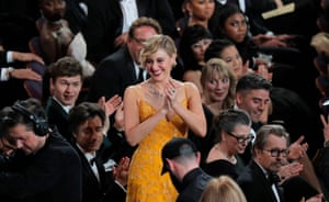 Greta Gerwig reacts as Guillermo del Toro is announced as best director