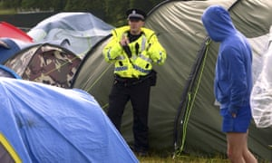 Police at a campsite at Scotland's T in the Park music festival at Strathallan castle in Perthshire.