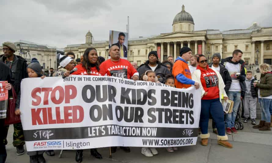 Members of Stop Our Kids Being Killed On Our Streets march to Downing Street with relatives of youths killed through gun or knife crime