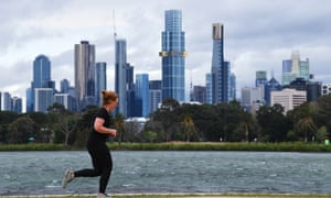 A person exercises at Albert Park in Melbourne.