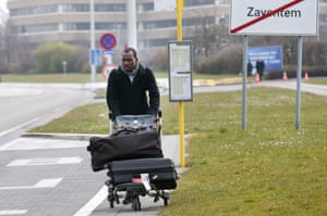 A passenger leaves Brussels airport, in Zaventem following its evacuation