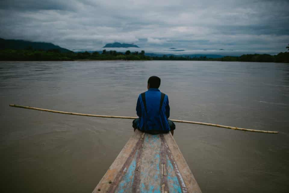 A man watches out for fish shoals on Rio Santiago, Peru