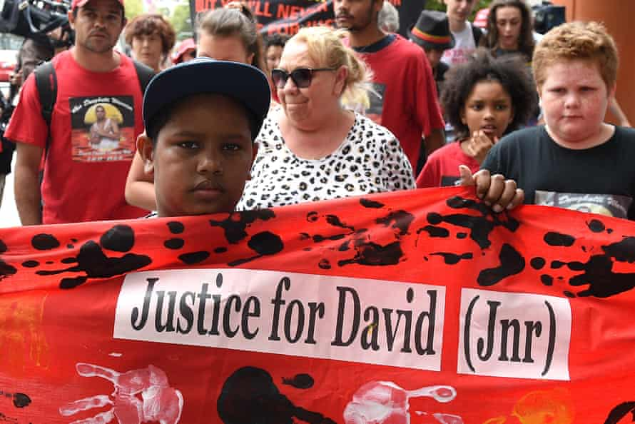 Protestors march to the offices of the New South Wales Department of Corrective Services on Thursday to demand answers over the death in custody of David Dungay Jr.
