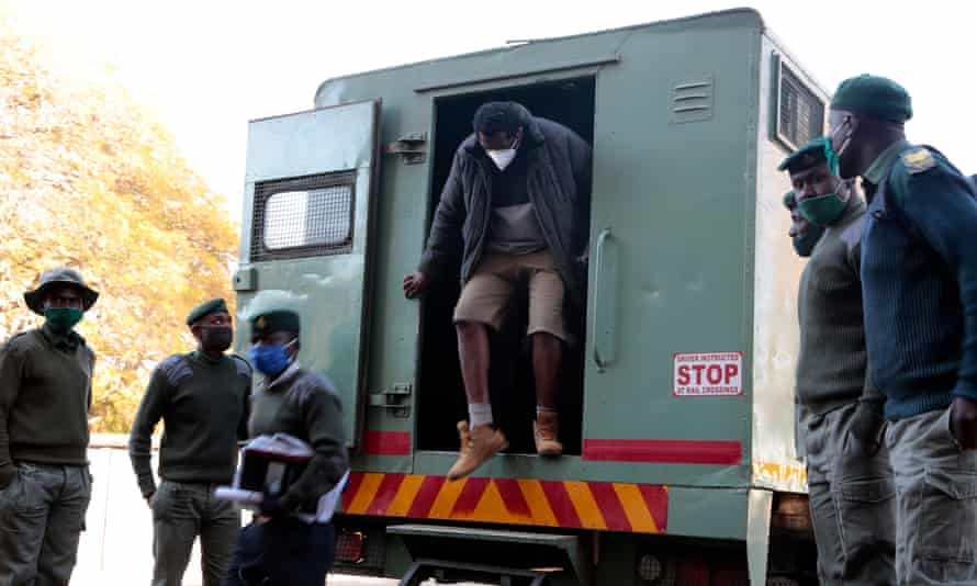 Hopwell Chin'ono gets out of a prison van as he arrives at Harare magistrates courts on Thursday.