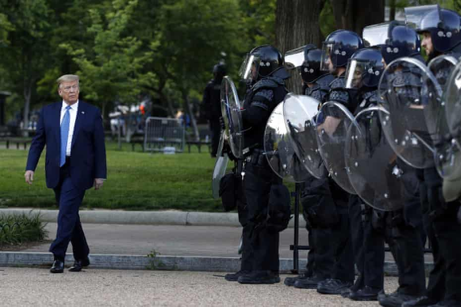 President Donald Trump walks past police carrying British-made Scorpion shields in Lafayette Square, Washington DC, on 1 June.