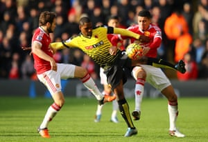 Watford's Odion Ighalo is crowded out.