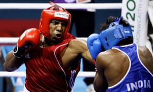 Tariq Abdul Haqq of Trinidad and Tobago (red) competes at the Delhi 2010 Commonwealth Games. He later died fighting for Isis in their self-declared 'caliphate' in Iraq and Syria.