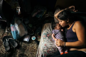 Fljurija Katunari, 18, with her two month-old daughter, Elvira, in a shack on the outskirts of Belgrade, Serbia.
