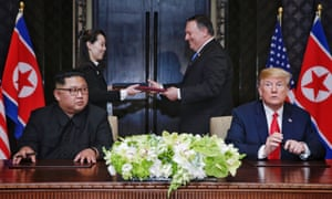 The US secretary of state, Mike Pompeo, and the North Korean leader's sister Kim Yo-jong exchange a document moments after it was signed by Donald Trump and Kim Jong-un in Singapore in June