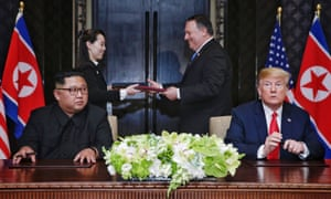 A document being exchanged between US Secretary of State Mike Pompeo (2-R) and North Korean leader's sister Kim Yo Jong (2-L) moments after it was signed by President Donald J. Trump and North Korean Chairmain Kim Jong-un during their historic DPRK-US summit today.