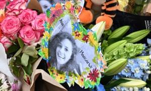 flowers during a vigil in memory of murdered Israeli student Aiia Maasarwe in Melbourne