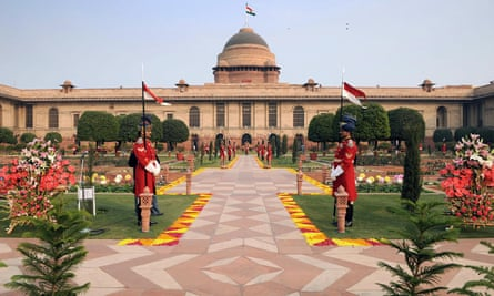 Guards stand in the Mughal gardens of the Indian Presidential Palace.