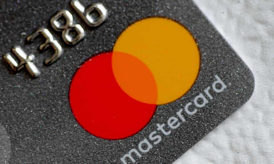 A Mastercard logo is seen on a credit card