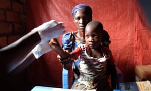 Annie Nalula, 38, and her seven-year-old son, Roger, at a mobile clinic in Cianciamka, in the Democratic Republic of the Congo's East Kasai province