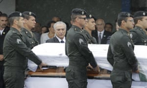 President Michel Temer attends the arrival ceremony of the Chapecoense players' coffins.