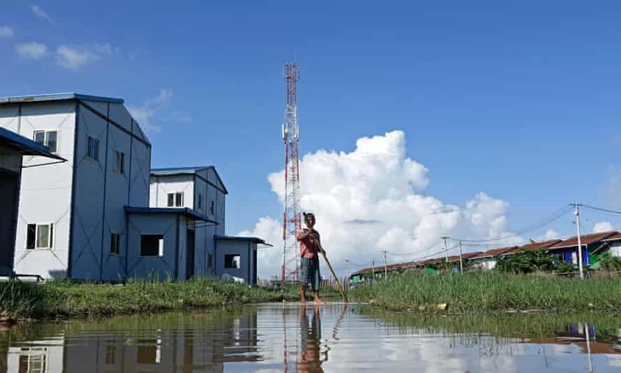 Rakhine childern play near a telecommunications tower at Sat Yoe Kya Ward in Rakhine state, Myanmar