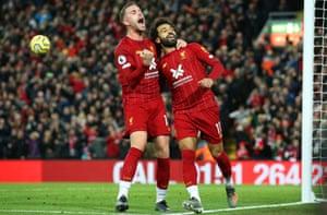 Mohamed Salah and Jordan Henderson celebrate Liverpool's winner.