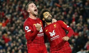 Liverpool's Mohamed Salah celebrates scoring their second goal with Jordan Henderson.