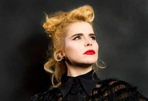 paloma faith poses in red lipstick for a headshot