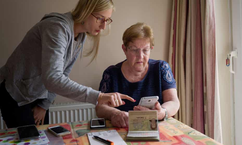 Doris Ratnam, a German citizen, trying to use the UK's settled status app, helped by Stephanie Dawoud.