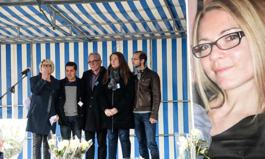 (L to R) Alexia Duval's mother Isabelle Fouillot, her husband Jonathann Duval, her father Jean-Pierre Fouillot, her sister Stephanie and her stepbrother Gregory Gay beside a poster of Alexia in 2017.