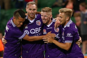 Milan Smiljanic , Rostyn Griffiths, Andy Keogh and Joseph Mills of the Glory celebrate a goal.