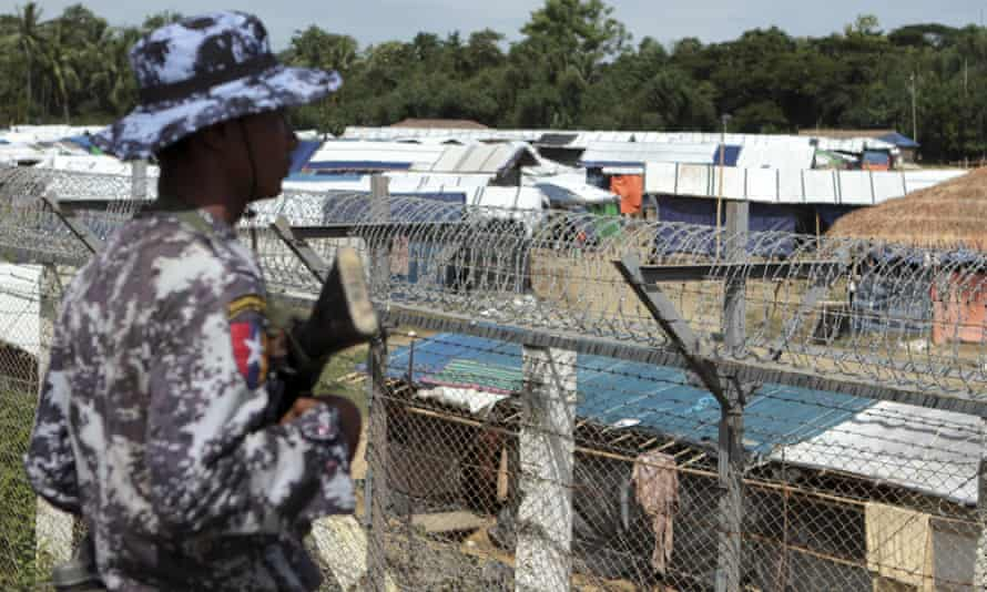 A Myanmar border guard monitors the border between Myanmar and Bangladesh, near Taungpyolatyar village, Maung Daw, northern Rakhine state.