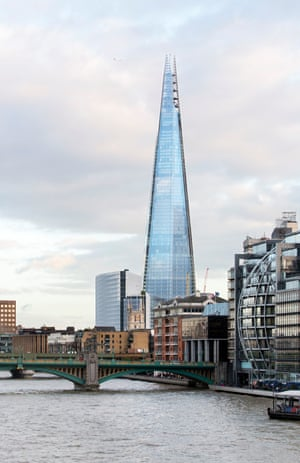 the shard skyscraper in london with the river thames in the foreground